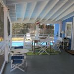 Screened in porch by the pool at Bead.
