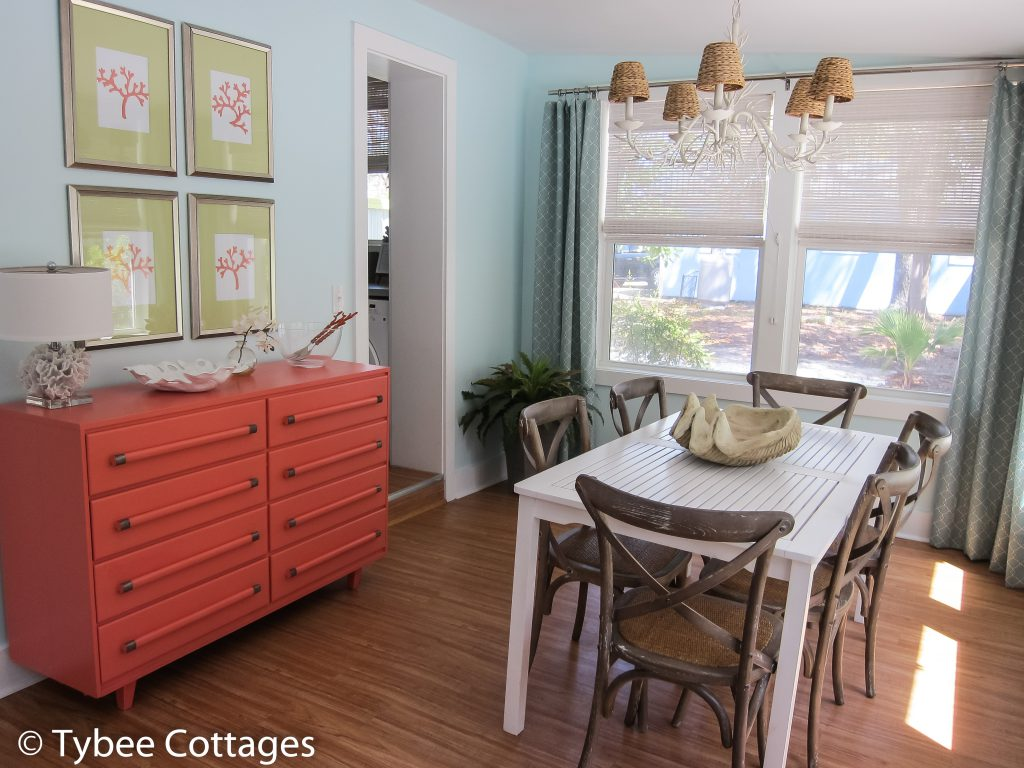 Coral Cottage - Dining Room Table with Coral Buffet and Chandelier.